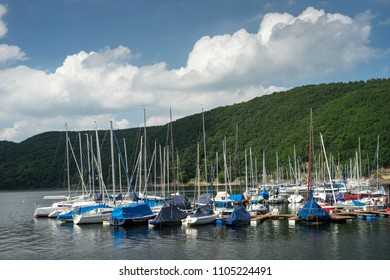 Boats on the lake in Rurberg, Simmerath area in Eifel National Park, North Rhine Westphalia, Germany