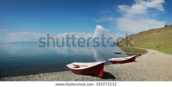 Boats on the lake shore of Hovsgol, tourism in Mongolia