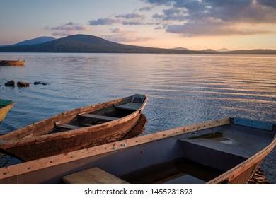Boats on the lake at sunrise