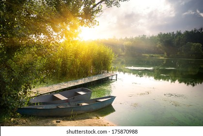 Boats on river at beautiful summer sunrise
