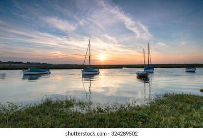 Boats on the river Glaven at Blakeney on the north coast of Norfolk