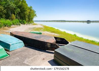 Boats on the shore of Étang de Lindre in Parc Naturel Régional de Lorraine, France