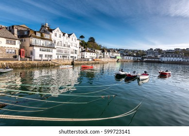 Boats on St Mawes harbour and river Cornwall England, with blue sea on a sunny summer day and town on the hillside