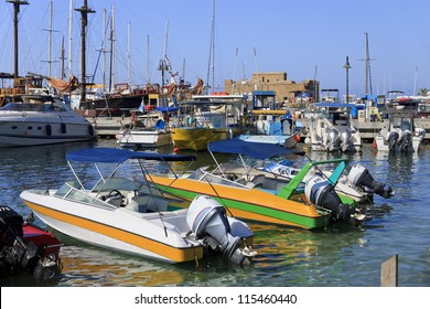 Boats at Paphos harbor with the castle in the background