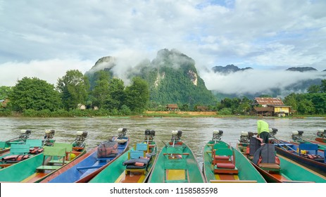 Boats Park in the Riverside Waiting the Tourists for Sightseeing in Nam Song River, Vang Vieng, Laos