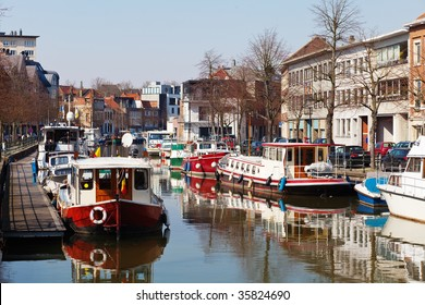 Boats parked along the channel in the city of Mechelen (Flanders region, Belgium)