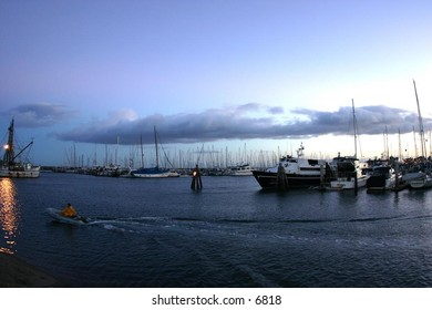 boats parked before a morning at sea