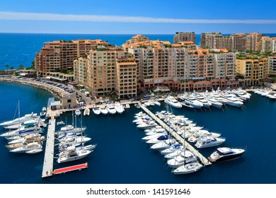 Boats parked in front of apartment houses in Monaco's quarter Fontvielle.