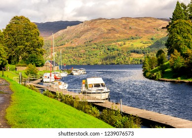Boats parked at south west part of Loch Ness lake where it meets Caledonian Canal at Fort Augustus, Scotland
