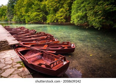 Boats parking at pier with crystal clear lake landscape of Plitvice Lakes National Park, UNESCO heritage. Plitvice Lakes are famous travel destination of Croatia.