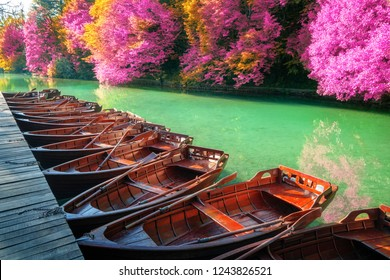 Boats parking at pier with turquoise lake landscape of Plitvice Lakes National Park, UNESCO heritage, famous travel destination of Croatia. The lakes are located in central Croatia (Croatia proper).