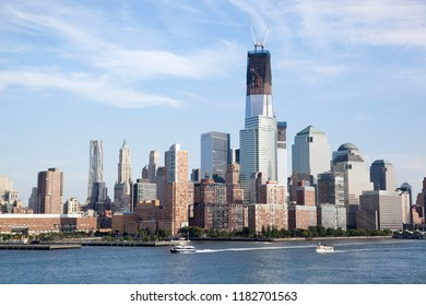 Boats passing by Lower Manhattan along Hudson River (New York City).