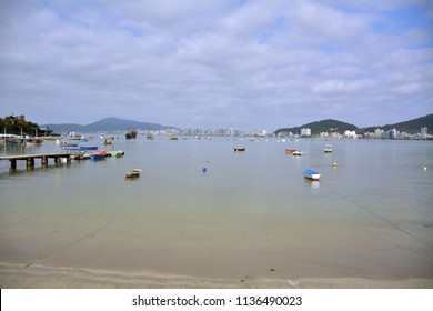 boats in port, small town with fishing boats, city of Itapema in Brazil, boats in fishing port, sea, cloudy sky anchored boats