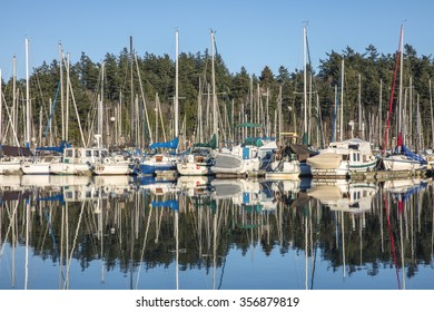 Boats reflected in harbor