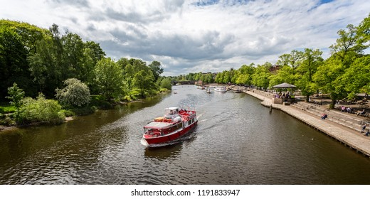 Boats and river cruisers on the River Dee in Chester, Cheshire, UK on 13 May 2017