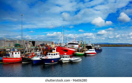Boats in Rossaveel harbor in summer, county Galway, Ireland.