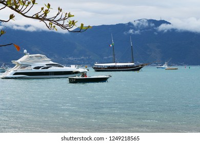 Boats and sailboats in Ilhabela with the background mountains, Brazil