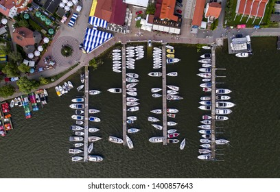 Boats and sailboats at marina in Poland, Mazury - drone view from above