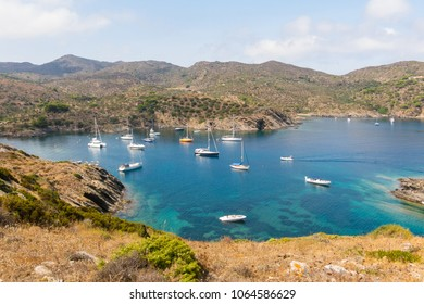 Boats and sailboats moored in a small bay in the Cap de Creus Natural Park, the westernmost point of Spain. Costa Brava, Catalonia, Spain.
