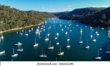 Boats sailing out of a channel in Northern Sydney