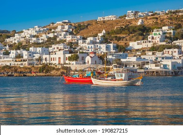 Boats in the sea bay near the town of Mykonos in Greece against the sky