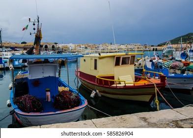 Boats and ships in Favignana island, Sicily, Italy.