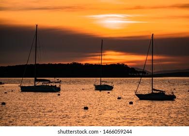 boats silhouette on a beatiful sunset in Punta del Este