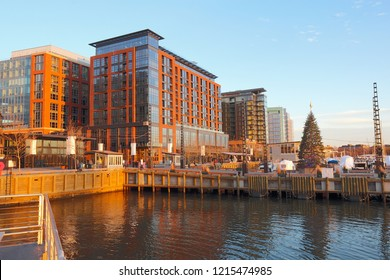 Boats and skyline of buildings at the newly redeveloped Southwest Waterfront area of Washington, DC viewed from the water with Christmas tree in fall
