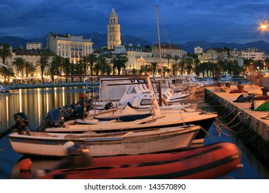 Boats at Split city harbor at night
