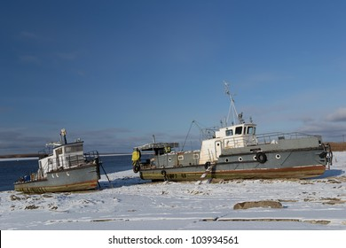 Boats standing on Irtysh river bank, near Khanty-Mansiysk