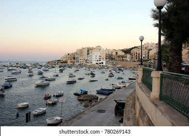 Boats at sunset at St Paul's Bay in Malta
