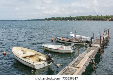 Boats tied to wooded dock on the see
