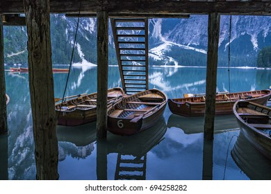 Boats under the house with reflection