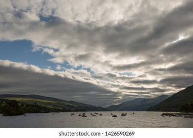 Boats under a moody sky in Perthshire