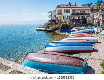 Boats upside down on the Ohrid lake shore in North Macedonia in spring