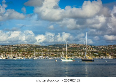 Boats and view of hills across Beacon Bay, from Newport Beach, California.