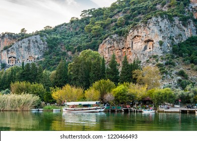 Boats view at slope of Lycians rock tombs in Dalyan Town