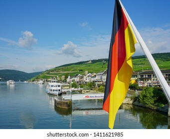 Boats, Vineyards and German Flag at Medieval Tourist Village of Rudesheim, Germany - Aug 2016