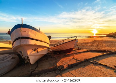 Boats in warm sunset light on the Fisherman's Beach (Praia dos Pescadores) in Albufeira, Portugal