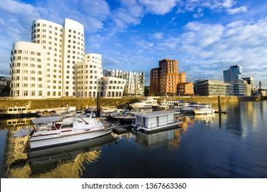 Boats in the Water and Buildings in the City Harbour Medienhafen Port in Dusseldorf Germany