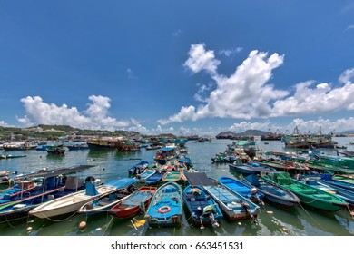 Boats white clouds and blue sky