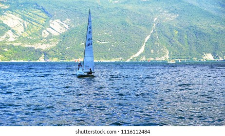 Boats and wind surf on Garda Lake
