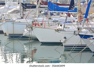 The boats and the yacht on the port.