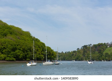 Boats and yachts moored on the River Dart Devon between Dartmouth and Totnes England UK