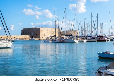 boats and yachts in old Venetian Harbour in summer sunny day, Heraklion, Greece