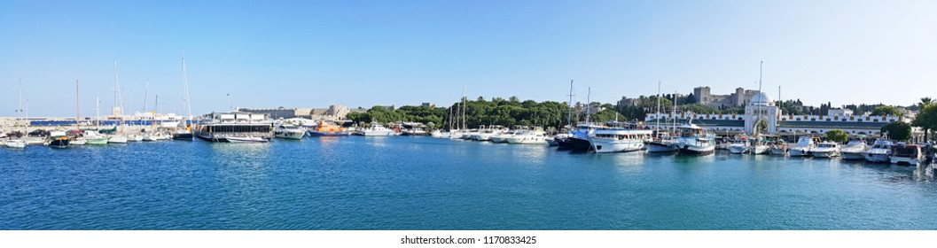 Boats and yatches in the Rhodes port in front fo the  Rhodes Marina Mandraki Mall and Rhodes castle