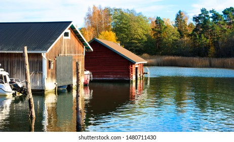 Boatsheds at Turku archipelago, Finland on a beautiful autumn day.