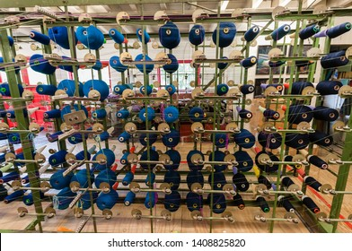 Bobbins of blue woolon a loom at Avoca Handweavers, Ireland
