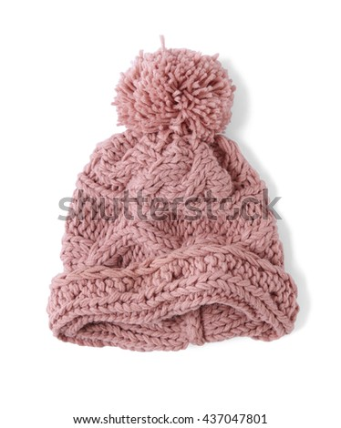794aa7adad8 Bobble hats - a pink knitted wool winter hat with pom pom isolated on a  white