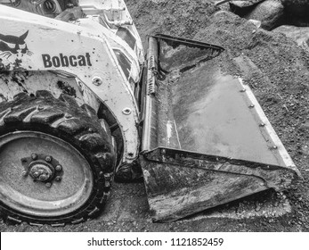 Bobcat skid steer loader working on construction site in the Twin Cities June of 2018
